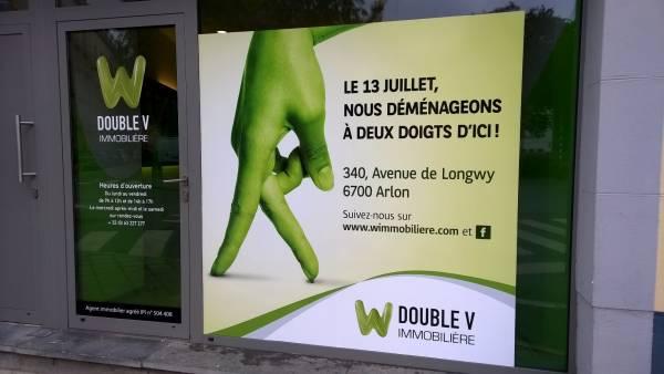 Double V Immobilière vitrine